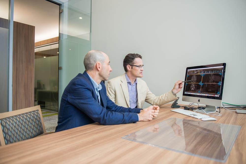 Dr Martin Wood and Dr James Bowman look at data on computer monitor